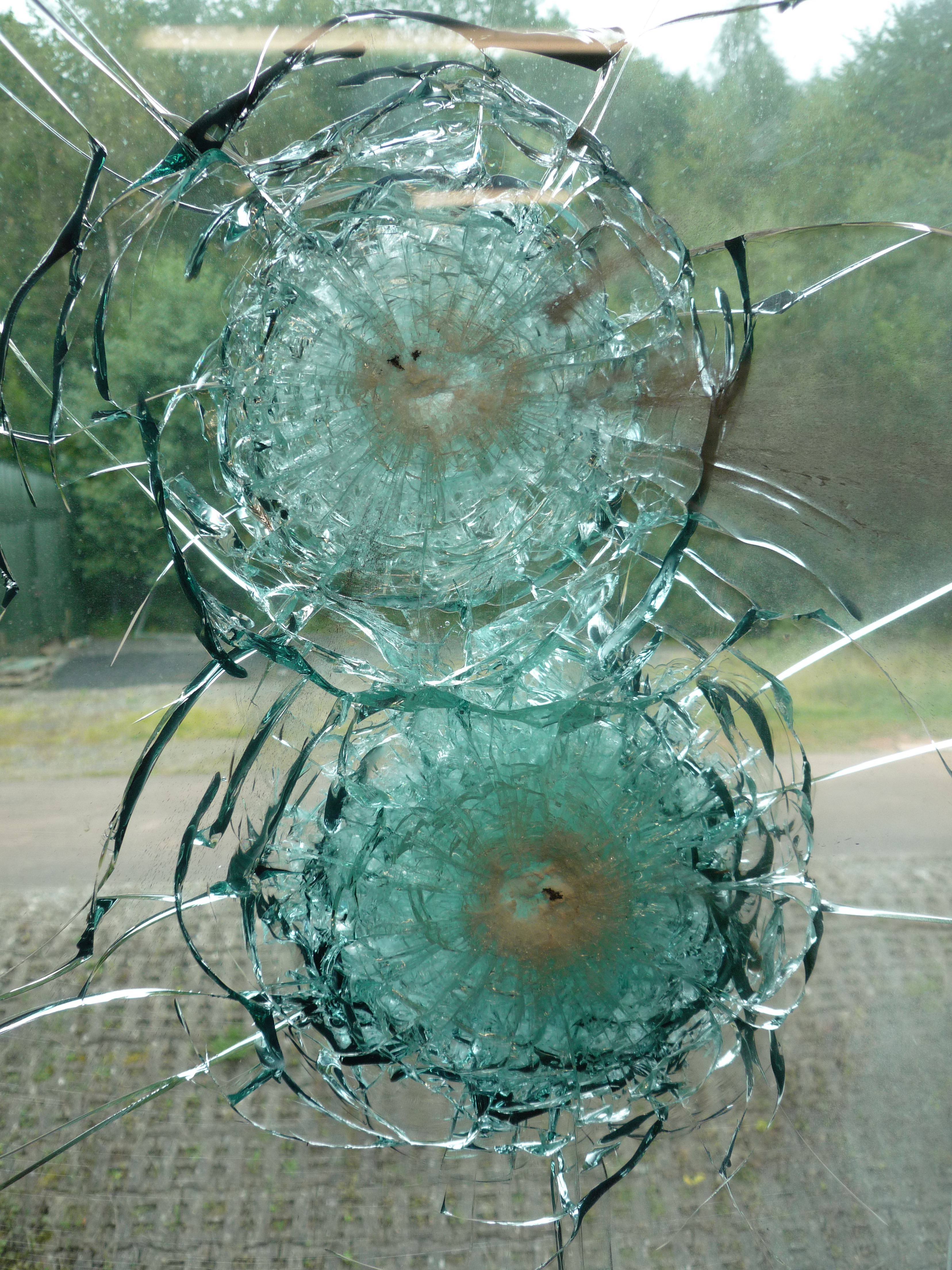 bullet resistant glass after impact from ammunition.